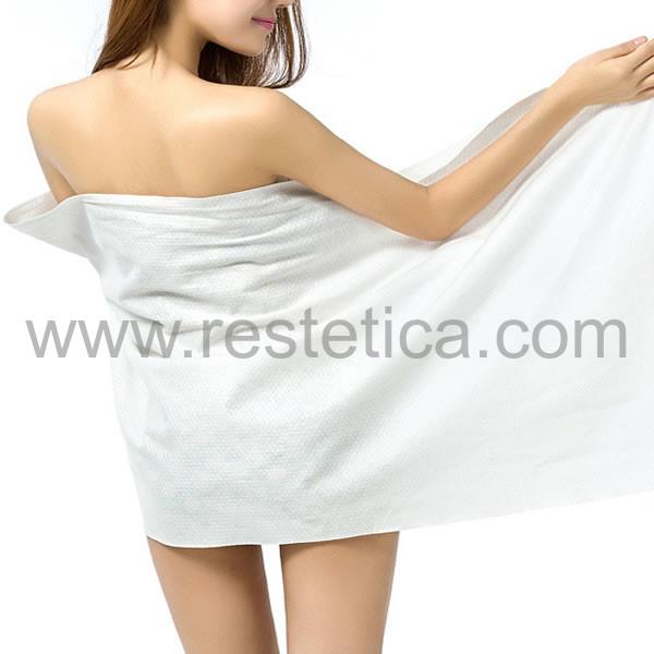 Telo asciugamano monouso in carta molto assorbente piegato singolarmente misura 96x150 cm - Confezione da 20 teli